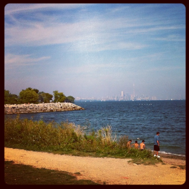 The view of downtown Toronto from the shoreline of Colonel Samuel Smith park.